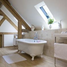 A freestanding bath is key to achieving a traditional look. If you prefer a fitted bath, a roll-top design will achieve a similar effect, and an old-fashioned washbasin stand like this one will complete the look. Here, a wooden floor adds a luxurious touc Loft Bathroom, Upstairs Bathrooms, Bedroom Loft, Small Bathroom, Bathroom Ideas, 25 Beautiful Homes, Edwardian House, Bathroom Design Inspiration, Bathroom Styling