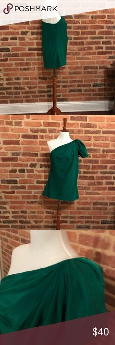 One shoulder emerald green top Emerald green one shoulder top! Perfect for the holiday season. The Limited Tops Blouses