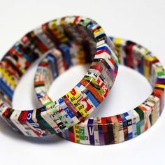Sport an eco-chic look with bangles and bracelets made from recycled magazines. Colored pages from magazines have been wrapped carefully around a wooden base to produce the funky style.