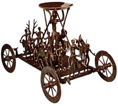 A Bronze Wagon with a female figure holding up a bowl and stags being led to sacrifice. l:35cm ht:27cm. From an urnfield grave site, Strettweg Austria.