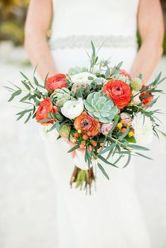 orange bouquet with succulents - photo by Cynthia Rose Photography http://ruffledblog.com/relaxed-destination-wedding-in-tulum #weddingbouquet #bouquets