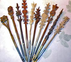 Beautifully carved dip pens from the Black Forest. Some of these have stanhopes that are optical devices that enable the viewing of micro photograph without using a microscope. When the viewer holds the glass cylinder in the center of the flowers to the light an image of a town is seen. These where sold as souvenirs from those areas. Some have multiple images. The 6th pen from the left has a picture of 'Interlakin et la Jungfrau'.(Switzerland)_Judith Walker's Collection