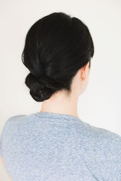 Simply braid your hair into a single plait down your back, and wrap it up into a bun.