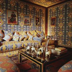 Valentino designed the fabric for the walls of his Roman living room himself, creating a cocoon of color for his villa on the Appian Way circa 1974.
