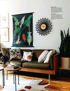 modern sofa, white walls and graphic artwork.