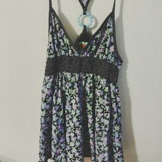 Free People Floral Tank Very cute summery floral tank by Free People. Blue glass bead on back. Excellent condition. Free People Tops Tank Tops