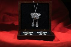 Silver filigree classic dangle earrings and a pendant by MIWunique