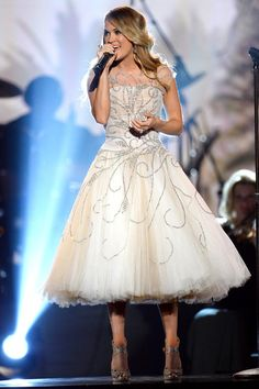 Carrie Underwood wears a dreamy, sparkly, princessy tulle gown while performing at the All-Star Salute to the Troops.