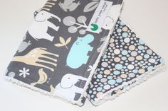 Baby boy burp cloths, set of 2, Baby Zoology and play dot with white Chenille. $13.00, via Etsy.