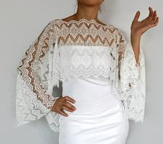 Bridal bolero shrug made with off-white wave patterned lace fabric. This romantic capelet will be a romantic complementary cover-up to your bridal