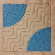 Watch a beginner quilter Josh Day learn how to quilt wiggles over his simple curved seam cheater drunkards path block. http://www.freemotionquilting.blogspot.com/2014/05/joshs-wiggly-lines-in-drunkards-path.html