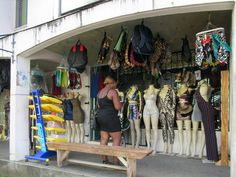 The latest Caribbean styles are displayed at Colours Fashion on Baptiste Street near the market in Castries on St. Colorful Fashion, Wardrobe Rack, Caribbean, Colours, Street, Walkway