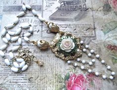 FUF 1/23/15 I finished up the last pendants from my WTW. Weathers overcast so it was hard taking pics though! Lots of B'Sue supplies on these! Some vintage rosary chain to and a resin flower treated with Lumiere and PP's. MockiDesigns