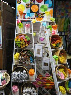 It is a decorative use of vintage ladders for arts and crafts show display, or retail store fixture. http://hative.com/creative-ladder-ideas-for-home-decoration/
