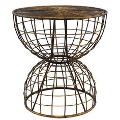 Crafted of metal in a brown finish, this industrial-inspired side table showcases openwork detailing with an hourglass silhouette.  ...