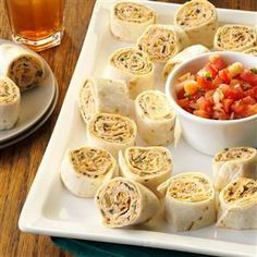 Fiesta Pinwheels Recipe -Whenever I serve these make-ahead appetizers, they disappear fast. When a friend at the office shared them with me, I knew in one bite I'd be bringing her recipe home for the holidays. —Diane Martin, Brown Deer, Wisconsin