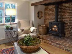 The cottage has a welcoming inglenook fireplace complete with cosy wood burner. Cottage Fireplace, Inglenook Fireplace, Fireplace Design, Cozy Fireplace, Fireplace Ideas, Fireplaces, Style Cottage, Rustic Cottage, Cottage Living Rooms
