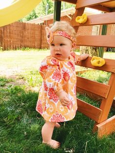 A St. Tropez Swing outfit is never quite complete without a matching headband and this little girl understands it perfectly!  Photo by Samantha Onderko of www.instagram.com/themarksmansdaughter. Fabric from Walmart. PDF sewing pattern designed by Mummykins and Me. Available for instant download at www.rebecca-page.com. Swing top sewing pattern – This chic Mommy & Me matching set comes in top or dress length. It's got a cute little cut out in the back, optional sleeves and an optional belt.