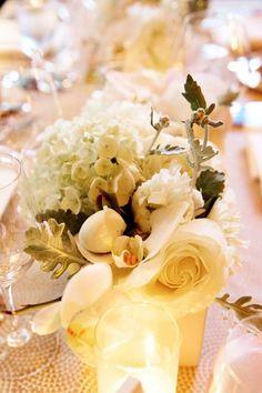 Elegant wedding centerpiece idea; Photo: Julie Weisberg Photography