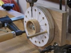 Radial Drilling Jig - Homemade radial drilling jig constructed from plywood and incorporating a printed guide glued to a wooden disc. A dowel serves to lock the jig in position during drilling operations.