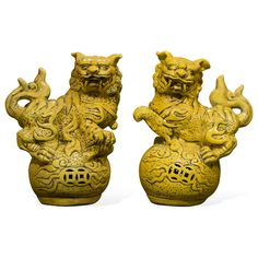 Always standing in pairs, Foo Dogs are fantasy lions in Chinese mythology who serve as guardians to prevent harmful things from happening to the family. This handsome pair are standing in commanding posture. The male, with a paw on a symbolic ball, protects the world, while the female, with a paw on a cub, protects the dwelling. This pair is painstakingly hand made by skilled craftsmen in China, with cracked yellow glazed finish. Great to display on a mantel or side table as a symbolic Asian…