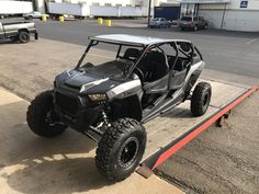 Vent Racing 4-seat FastBack cage on a 2017 Polaris Turbo RZR in flat black with a raw aluminum roof.