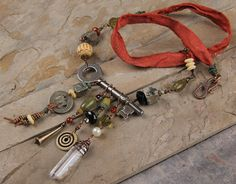 Lost and Found necklace: Vintage skeleton key, sari silk ribbon, subway token, crystal point, leather, mixed media