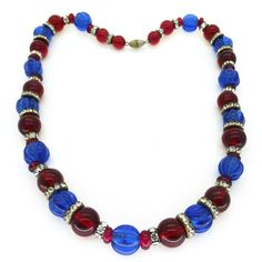 The most beautiful Art Deco bead necklace featuring unusual blue melon glass beads with tiny curves embedded around each bead. The melon beads have...