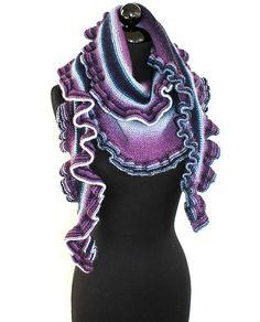 Travelling Ruffles by Angela Juergens. Uses one of my favorite yarns, Zauberball.