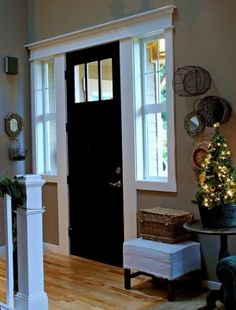 Another picture of an interior black front door! I did this to our interior front door and it looks AWESOME! by allisonn (for back room - including the painted door - perfect! Home, House Styles, Christmas House Tour, Home Remodeling, New Homes, House, Black Doors, House Interior, Doors Interior