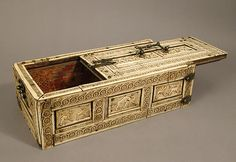 12th Century Casket with Erotes & Animals made with Bone Plaques & Ornamental Strips over Wooden Casket with Silk Lining; Copper Handle, Clasps, Lock Plate, & Nails