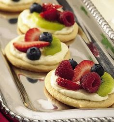 Mini Sugar Cookie Fruit Pizza; Bake or buy your sugar cookies.  Spread strawberry cream cheese on top.  Slice strawberries, kiwi, grapes, etc., and decorate each cookie. Keep it simple.  Arrange your mini fruit pizzas on a pretty platter and there you have it.