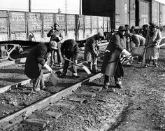 African American women working on a railroad crew. They perform track maintenance in near-zero weather in Chicago. They fill jobs vacated by men entering the military during World War II. Nov. 26, 1943. (CSU_ALPHA_1085) CSU Archives/Everett Collection