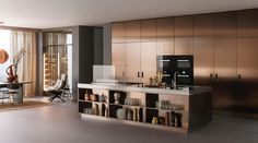 Arclinea's new range of doors bring the allure of coloured metal and practicality of stainless steel to their inimitable designs.