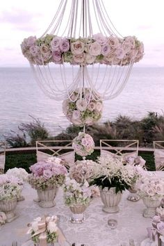 Elegant Vintage tablescape with abundant roses    love the chandelier effect.