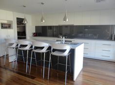 White kitchen with grey splashback   Concealed rangehood
