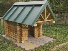 Add architectural interest to your yard and give your dog his own retreat with a sturdy rustic-style doghouse.