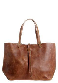 leather bag this would look great with skinny jeans and a cream blouse and nude  coloured heels. x
