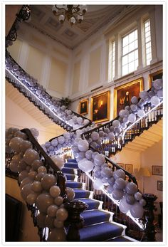 An eclectic, whimsical London wedding featuring gorgeous ashy balloons under-lit by neon via 100 Layer Cake Prom Decor, Wedding Decorations, Deco Ballon, 100 Layer Cake, Banisters, Banister Ideas, Staircase Railings, London Wedding, Balloon Decorations