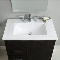 """Kira sink for Daytona vanity, Empire.  Ceramic.  Only in white.  24"""".  Only available holes are single or 8"""" spread.  Bummer - would have preferred 4 """" centerset.  $325.  http://www.kitchensource.com/bathroom-sinks/ei-bv1896.htm"""