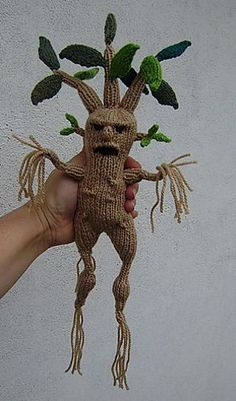 """I can see a baby shower and the preggo opens up a gift with this knitted mandrake in it!- - then flash forward two years and it is being dragged around by one of it's leaves by baby """"Tonks""""!"""