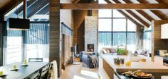 High ceilings and a large floor-to-ceiling window to the surrounding nature create the airy atmosphere of this compact living room. Hotel Chalet, Log Home Living, Luxury Cabin, My Ideal Home, Compact Living, Villa, Floor To Ceiling Windows, Japanese House, House Made