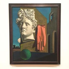 """themuseumofmodernartGiorgio de Chirico, born today in 1888, created what he called """"metaphysical"""" paintings, in that they were representations of what lies """"beyond the physical"""" world. Several of the artist's paintings are on view now on the museum's Fifth Floor. [Giorgio de Chirico. """"The Song of Love."""" Paris, June-July 1914. The Museum of Modern Art, New York. © 2015 Artists Rights Society (ARS), New York / SIAE, Rome]"""