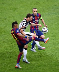 Stephan Lichtsteiner of Juventus is challenged by Andres Iniesta and Neymar of Barcelona during the UEFA Champions League Final between Juventus and FC Barcelona at Olympiastadion on June 6, 2015 in Berlin, Germany.