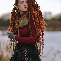 Brave. Featuring the beautiful curly accent dreads by @tytodreads tucked into my gingery locs