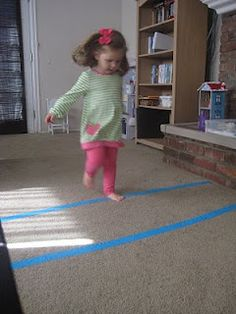 Olympic hurdles using tape from The Activity Mom