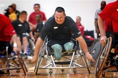 U.S. Army Sgt. 1st Class Jacque Keeslar wheels through a match of wheelchair basketball on the first day of games at the inaugural Warrior Games at the U.S. Olympic Training Facility in Colorado Springs, Colo., May 11, 2010. DoD photo by Fred W. Baker III