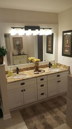 Traditional style two bowl two sink double vanity. bathroom decorating with yellow flowers. LED wall bathroom lighting above vanity. White wooden vanity with brown/black fixtures. Stone Bathroom, White Vanity Bathroom, Beige Bathroom, Yellow Bathrooms, Bathroom Countertops, Large Bathrooms, Brown Bathroom Decor, Ikea Bathroom, Bathroom Closet