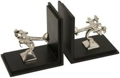 IMAX Up in The Air Bookends by IMAX. $49.79. IMAX Worldwide-One Source. A World of Choices. Set includes two ,each measures 5 inches h by 5 inches w by 3.5 inches. A handsome addition to any home or office library. Bookends feature aluminum models of vintage aircraft. Due to the artisan crafted nature of this product, no two will be identical. Up In The Air Bookends --Handcrafted with gorgeous detail, these charming bookends feature artisan crafted models of vi...