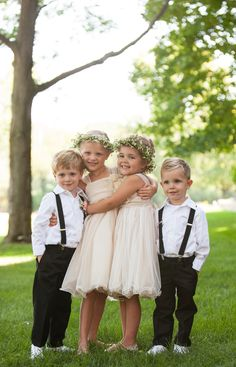 Flower girls with flower crowns and ring bearers with suspenders